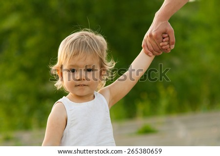Toddler wearing a white sleeveless dress with dirty face outdoors - stock photo