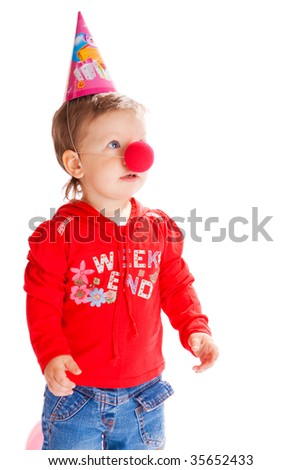 Toddler with a funny nose and birthday hat on - stock photo