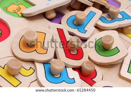 toddlers jigsaw puzzle helping to learn the alphabet