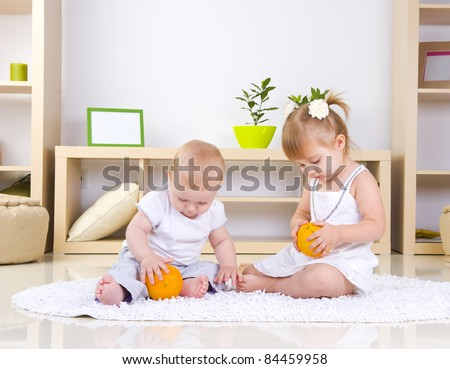 Toddlers Playing at home.Kids - stock photo