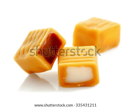 toffee caramel candy with chocolate and cream filling isolated on white background  - stock photo