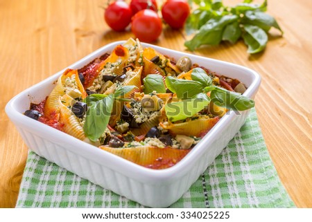 Tofu and Spinach Stuffed Shells Baked with Tomato Pasta Sauce