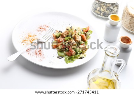 Tofu and vegetables salad. Olive oil, spices, pumpkin and sesame seeds. White background