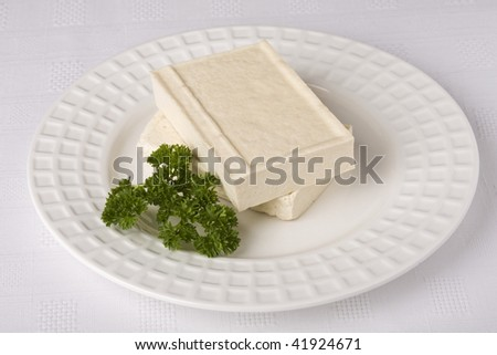 Tofu cheese on a white dish isolated. It has a clipping path. - stock photo