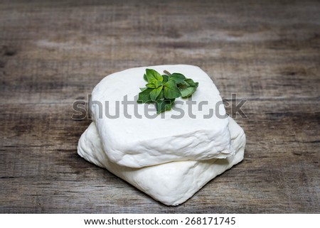 tofu cheese on wooden background - stock photo