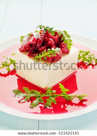 Tofu cheese with marinated broccoli and beet mushrooms in sauce. Shallow dof.