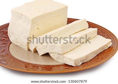 Tofu cubes on plate isolated on white background