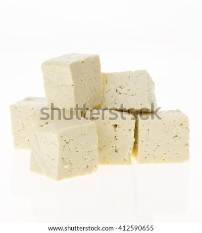 Tofu cut into cubes, isolated on white background. - stock photo