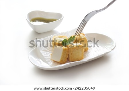 Tofu fish in white plate on white background - stock photo