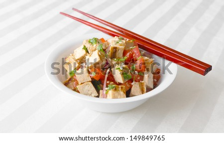 Tofu Salad - Grilled tofu tossed together with tomatoes, onions, and cilantro. - stock photo