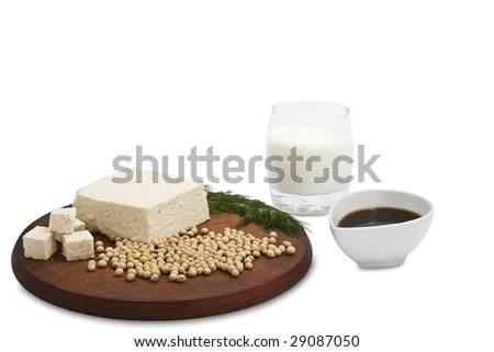 Tofu, soy beans, soya milk and sauce isolated on white. Focus on tofu. It has a clipping path. - stock photo