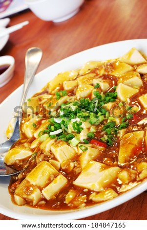 Tofu stir fried pork in red sauce of China. - stock photo