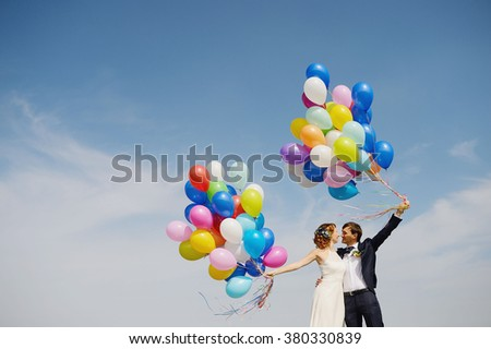 together forever with balloons in the sky