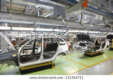 TOGLIATTI - SEPTEMBER 30: Bodies of new passenger carsr at Avtovaz factory on September 30, 2011 in Togliatti, Russia. In 2013, Russia largest carmaker Avtovaz celebrating 47th birthday. - stock photo