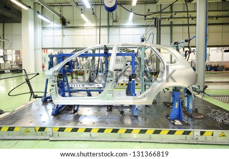 TOGLIATTI - SEPTEMBER 30: Equipment for accurate measurement of car bodies at Avtovaz factory on September 30, 2011 in Togliatti, Russia. V.Putin signed decree awarding state awards to AvtoVAZ. - stock photo