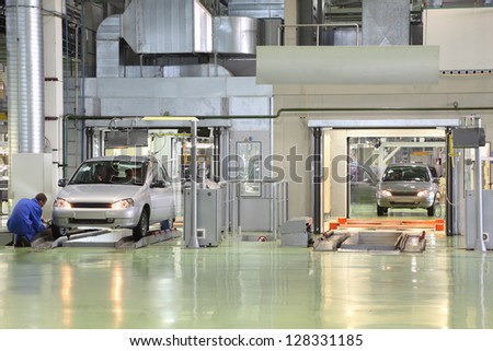 TOGLIATTI - SEPTEMBER 30: Test of new cars Lada Kalina at factory VAZ on September 30, 2011 in Togliatti, Russia. In 2012, AvtoVAZ sold in Russia, more than 530 000 vehicles. - stock photo