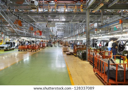 TOGLIATTI - SEPTEMBER 30: Workshop with car assembly lines at factory VAZ, September 30, 2011, Togliatti, Russia. In first five months of 2011, Kalina took first place in number of cars sold in Russia - stock photo