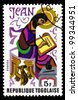 TOGO - CIRCA 1978: A post stamp printed in the Republic of Togo shows John the Evangelist, circa 1978 - stock