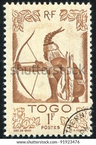 TOGO - CIRCA 1947: A stamp printed by Togo, shows hunter, circa 1947