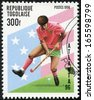 TOGO - CIRCA 1996: A stamp printed in Togo dedicated to bandy player Games of Atlanta Olympiad, circa 1996 - stock photo