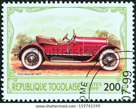 """TOGO - CIRCA 1999: A stamp printed in Togo from the """"Antique Automobiles"""" issue shows a Stutz Bearcat, 1921, circa 1999.  - stock photo"""