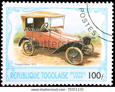 TOGO - CIRCA 1999: A stamp printed in Togo showing vintage car, circa 1999 - stock photo