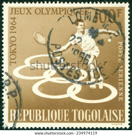 TOGO - CIRCA 1964: A stamp printed in Togo shows tenisist, series Olympic games in Tokyo, circa 1964