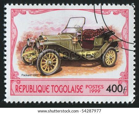TOGO - CIRCA 1999: stamp printed in Togo, shows retro car, circa 1999. - stock photo