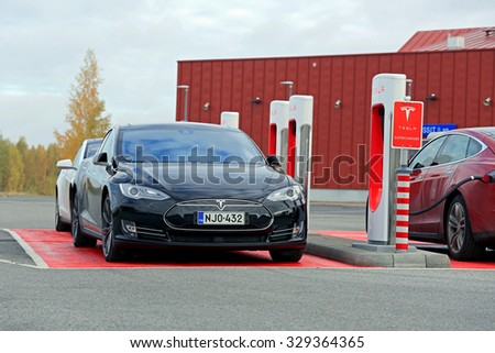 TOIJALA, FINLAND - OCTOBER 17, 2015: Three Tesla Model S cars are being charged at Tesla Supercharger station. Currently there are two Tesla Supercharger stations in Finland.  - stock photo