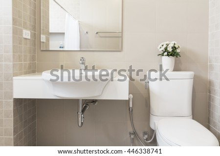 toilet and bathroom in simple style. - stock photo