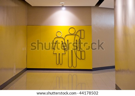 Toilet and Phone sign inside a modern shopping mall. - stock photo