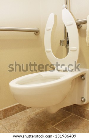 Toilet bowl with open lid - stock photo