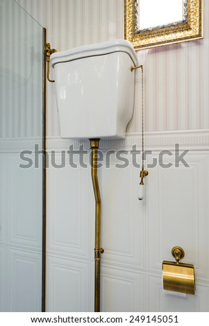 toilet cistern in bathroom interior - stock photo