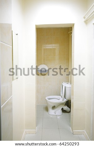 toilet inside one seat tan wall tiles
