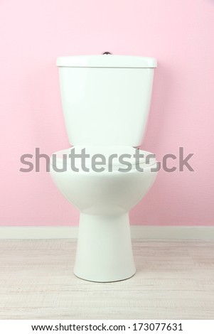 Toilet paper on a toilet, close-up - stock photo