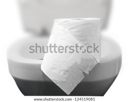 toilet paper on a toilet, concept for constipation and bowel movement - stock photo