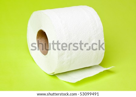 toilet paper on green background - stock photo