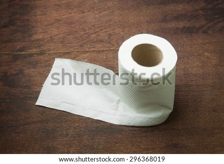 Toilet paper on wood table. - stock photo