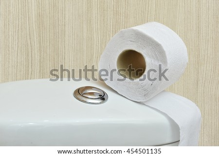 toilet paper place on flush toilet