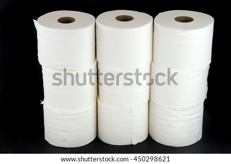 toilet paper rolls on black background