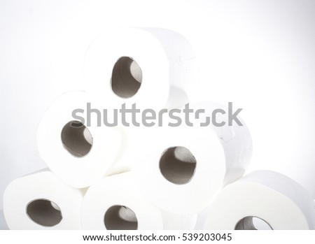 Toilet paper-Tissue paper roll. The reel of the toilet paper on the white background. Roll of toilet paper- Cheap wc wiping paper product  hygienic purposes.Rolls of toilet paper. Wc papers.