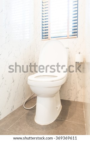 Toilet seat in toilet room interior