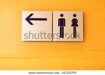 Toilet sign and direction with copy space - stock photo