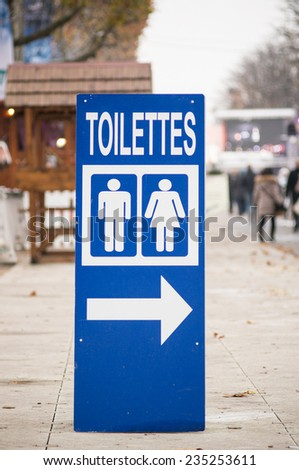 Toilet sign on the Champs Elysees Street, Paris, France - stock photo