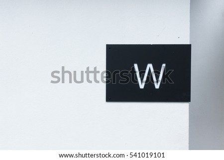 Toilet sign on the wall