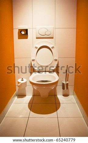 Toilet with an open lid and romantic lighting - stock photo