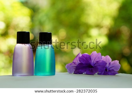 Toiletries and flowers for tropical spa concept