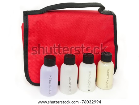 Toiletries in front of a red toiletries bag - stock photo