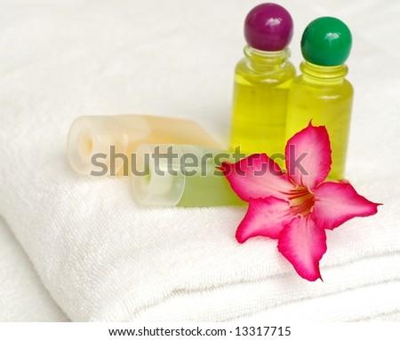 Toiletries on white towel - stock photo