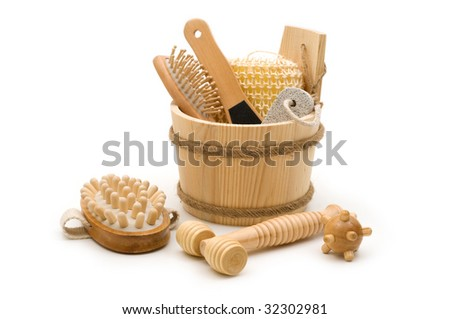 Toiletry and skincare wooden accessories in the wooden bucket - stock photo